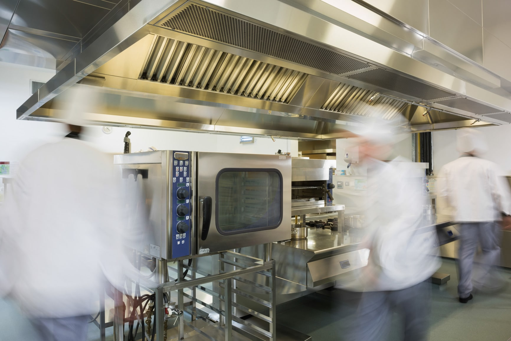 photodune-8475515-team-of-chefs-working-in-a-commercial-kitchen-at-a-hurried-pace-m1